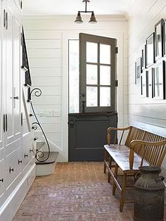 Like the idea of dutch door if ther is a screen/storm door also, love the storage under the stairs-- it's a great idea even w/o having stairs. like the montage of pictures and bench as well.