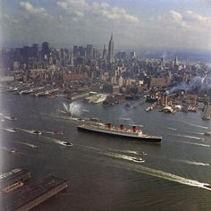 In 1967, Queen Mary departs New York for the last time, escorted by tugs, fireboats and assorted other small craft.