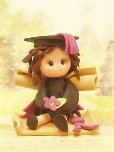 """*POLYMER CLAY ~ Graduation baby fairy. Don't know about """"baby"""" and """"fairy"""" but like the girl grad."""