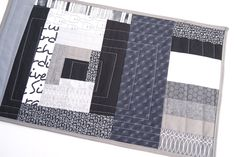 Patchwork Mini Quilt in Abstract Log Cabin Design, Eclectic Place Mat in Black, White and Grey Fabrics by MyBitOfWonder on Etsy https://www.etsy.com/listing/267953182/patchwork-mini-quilt-in-abstract-log