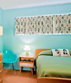 Cheery, bright mid century bedroom.   Hey-Wake furniture with a little kitsch.   I love the window treatment.