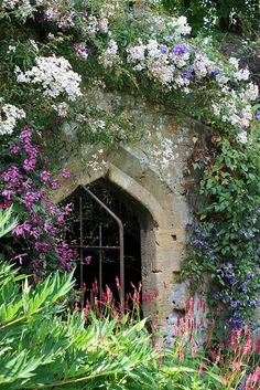 beautiful gate in flower-covered wall