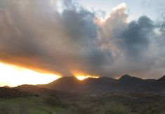 October Fiery golden glare through the break-up at sundown over in Snowdonia, Breakup, Wales, October, Clouds, Mountains, Breaking Up, Welsh Country, Bergen