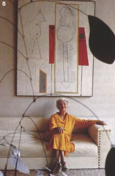 Peggy Guggenheim at her home on The Grand Canal, Venice … mid 1950's. In the background L'Atelier (Pablo Picasso) and in the foreground Arc of Petals (Alexander Calder).
