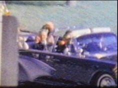 Governor Connally and Jackie Kennedy even front seat are all head turned to Umbrella Man