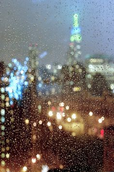 New York City bokeh by Filip.G  This is the way I first saw NYC--just beautiful in the evening in the rain:)