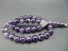 Hand-crafted Tasbih - Misbaha - Prayer Beads made with genuine amethyst beads.    Beads Dimension: 8mm  Length incl. tassel: 9 inches (23 cm)      If