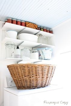 Organized Laundry Room - great open shelves and love the blue ceiling