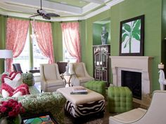 Living Room: Brightly Colored Living Room. colors for living room. soft green living room. pink curtain. zebra print ottoman coffee table. green tufted ottoman. classic pattern sofa. shelf top fireplace. framed wall art.