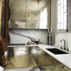 Stunning #kitchen in silver leaf gold with #grey #marble #splashback #clean #white #worktop #magnificent #stylish #elegant #MonacoInteriors #creativity #architecture #designers #interior