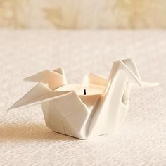 Porcelain Origami Candle Holder $28 Made me think of Kim