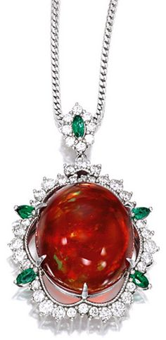 FIRE OPAL, EMERALD AND DIAMOND PENDANT Centring on a fire opal of reddish orange colour weighing 21.47 carats, to a surround set with brilliant-cut diamonds together weighing approximately 1.60 carats, highlighted by five marquise-shaped emeralds, mounted in platinum, accompanied by a platinum link-chain, length approximately 480mm.