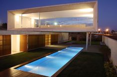 Concrete volume with large uninterrupted glass | Marcio Kogan | Brazil