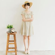 cute and simple for spring.  With a dress like this, don't pick anything blue or it will look like a hospital gown.