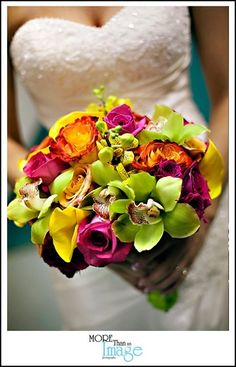 roses, orchids and callas in shades of yellow, green, orange and pink