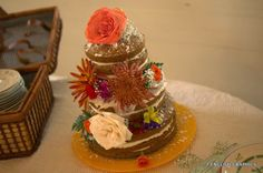 Naked carrot cake with blooms.