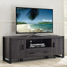 Complete your living room makeover with this 60-inch charcoal gray TV stand. Ample top space on this wood entertainment storage console accommodates a flat-panel television that is up to 60 inches wid