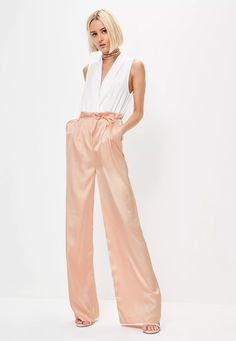 Need something sleek to take you from desk to drinks? Look to these satin pants - featuring a wide leg style, paperbag waist with tie detailing and a blush pink hue.
