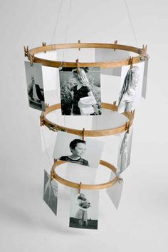 Turn embroidery hoops into a unique photo chandelier. Could paint or darken the hoops!