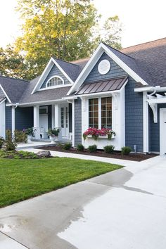 Lake House Exterior - Dark grey charcoal vinyl shake siding with white trim, pergola, window boxes and corbel details.