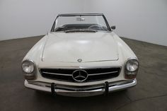 1966 Mercedes Benz 230SL, 2 tops, white with black interior, manual transmission, notches on both fenders, clean and presentable, nice weekend driver that is mechanically sound. For $22,750  If you have any additional questions Please call 310-975-0272