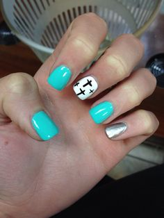 Acrylic nails with a cross design