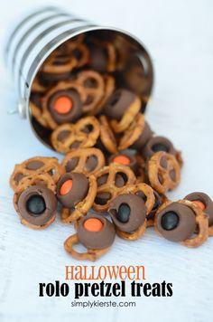 Use orange & black M&M's to add a fun Halloween flair to the easy and fun Rolo Pretzel Treats