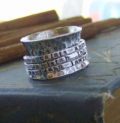 Hand Stamped Tripple Band Sterling Silver Spinner Ring Mothers Ring... good idea for the future. Love this look.
