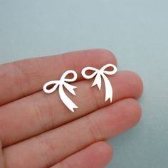 Bow Earrings in sterling silver, large studs, romantic earrings. $70.40, via Etsy.