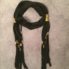 """Black scarf w beads - GET MY 3 SCARVES FOR $20! This fashionable scarf with fringe has gold beads and baubles that you can adjust to up and down to your liking. 66"""" long. Very stylish! Accessories Scarves & Wraps"""