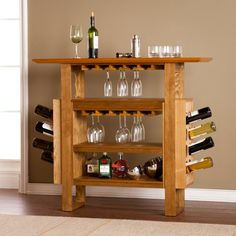 Clean simplicity creates quiet elegance in this handsome weathered oak console bar. Airy and open shelving, glassware racks and bottle holders organize your hosting needs with ease while the ample tabletop provides excellent space for serving appetiz Home Bar Furniture, Entryway Furniture, Adams Furniture, Reclaimed Furniture, Natural Oak Flooring, Console Cabinet, Wooden Console, Bar Console, Modern Bar