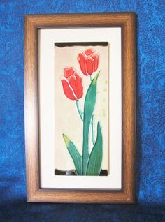 Vintage Tulip Bloom Accent Art-the decorative tile pictures two tulips with a slight shade of yellow on the tips of their bright red pedals.