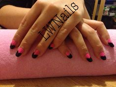 Bright pink and black rounded acrylic nails
