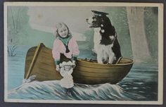 """Antique Postcard Newfoundland Dog & Child..Printed on the back of the postcard, """"May your Christmas be as happy as Doggie's and mine."""" .."""