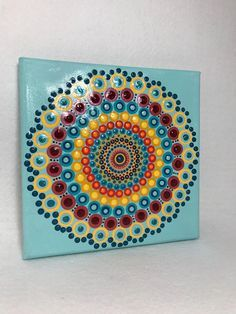 Original Mandala Painting on Canvas, Dotilism, Dot Painting, Aboriginal Art, Henna Meditation Art, Healing/Calming, Hand Painted Acrylic paint on canvas, sprayed multiple times with high gloss sealer to protect paint and aging. Colors are: reds, yellows, turquoise Background Color: Blue