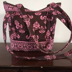 """Pretty Pink and Brown Quilted Tote Great pink and brown quilted tote.  EUC.  Double strap.  Zippered closure.  Front pocket.  Interior has 6 pockets (2 large, 4 small).  Very minor piling.  12"""" strap drop.  9x3x10.  So pretty! Bags Totes"""