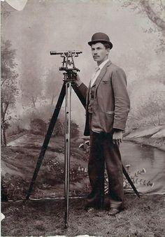 Surveyor Posed an His Transit