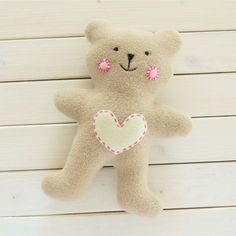 Learn to sew a simple teddy bear, a cute baby gift with free pattern and step by step tutorial.