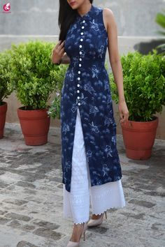 As temperature rises a few digits, it's time to acquire a whole new wardrobe with this beautiful Blue Tropical Print Modal Rayon Kurti with White Chikankari Full Lining Cotton Palazzo with pocket from Colorauction. The Modal Rayon fabric makes this kurti Dress Neck Designs, Kurti Neck Designs, Kurta Designs Women, Kurti Designs Party Wear, Printed Kurti Designs, Simple Kurti Designs, Unique Prom Dresses, Stylish Dresses, Latest Indian Fashion Trends