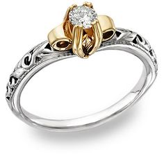 ApplesofGold.com - Art Deco 1/4 Carat Diamond Ring - 14K Two-Tone Gold, $625!  This engagement ring revels in the Art Deco period design. Swirling flower and petal motif is delicately etched into the smooth 14k white gold band. An intricate, lustrous yellow gold lotus flower opens to offer one solitaire, precious, brilliant round diamond.