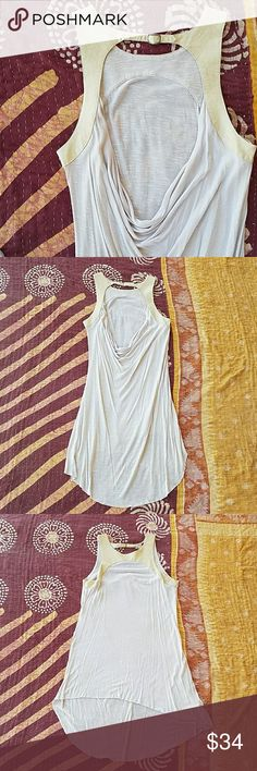 Free People Open Back Drape High Low Tunic XS Ivory Free People tunic top Draped open back with buckle closure at neck  Faux leather fabric on shoulder and neckline Lightweight jersey with a raw edge and a high low hem There is a tiny pinhole on the front of the faux leather, to me it's not noticeable and still has a lot of wear left ? Other than that it's in good condition  Made by Free People, size XS Free People Tops Tunics