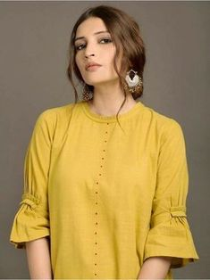 Looking for beautiful neck designs for plain Kurtis/Kurthas ? Here are 20 flattering designs that can add a dash of style to your kurti style.Different types of sleeves often found in vintage clothing - ArtsyCraftsyDad Plain Kurti Designs, Simple Kurti Designs, Salwar Designs, Kurta Designs Women, Kurti Designs Party Wear, Neckline Designs, Dress Neck Designs, Sleeve Designs, Blouse Designs