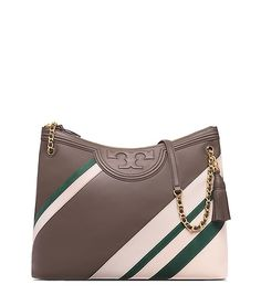 Graphic lines and chains: the link to a pulled-together look. Our new Fleming Stripe Tote is made of supple leather detailed with unique color-blocking and an embossed logo. Finished with a secure zip