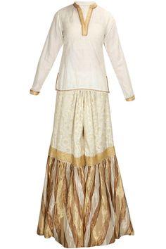 Ivory and beige floral chanderi brocade garara by Kotwara.   Shop now: http://www.perniaspopupshop.com/designers/kotwara-by-meera-and-muzaffar-ali  #shopnow #perniaspopupshop #Kotwara #ethnic #traditional #heritage #pastperfect