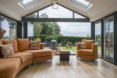 With the bi-folding doors completely opened the living room and garden almost blend into one space House Extension Design, Glass Extension, Extension Designs, Rear Extension, Express Bi Folding Doors, Single Storey Extension, Aluminium Windows And Doors, Roof Lantern, Front Door Entrance