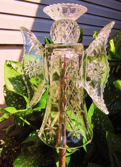 This beautiful glass garden art sculpture has been made from recycled glass purchased at antique or thrift stores. It has been bonded together
