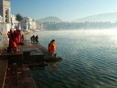 Women at one of the 52 ghats on Lake Pushkar at Pushkar, Rajasthan, India