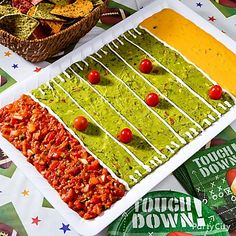 Edible Football Field - use guacamole as the playing field with salsa and nacho cheese for the end zones. Pipe on sour cream to mark the yard lines and add some cherry tomato players, serve with tortilla chips for dipping.