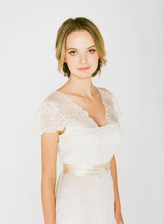 LD6015 l This embroidered silk chiffon dress with a delicate scallop-edged neckline and cuff cap sleeves will make any romantic bride swoon. The carefully embroidered leaf pattern was created by Saja to have a one of kind lace design for our brides. LD6015 has embroidery through the front of the dress with a low plunge back neckline. #sajawedding