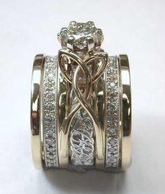 deSignet International raru.com: 14Kt yellow gold Open Wire Reverse Cradle, custom 14Kt white gold removable insert band, two diamond eternity bands and two plain gold rails. #weddingring